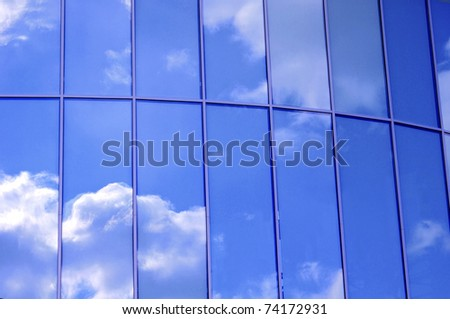 Business building windows and sky reflection - stock photo