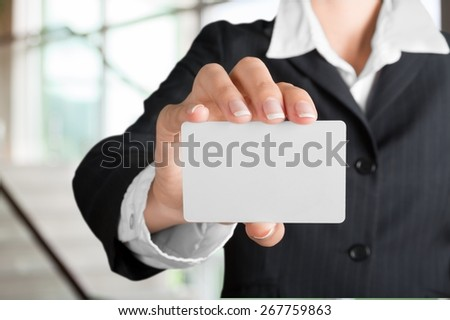 Business. Business card - businesswoman holding blank sign - stock photo