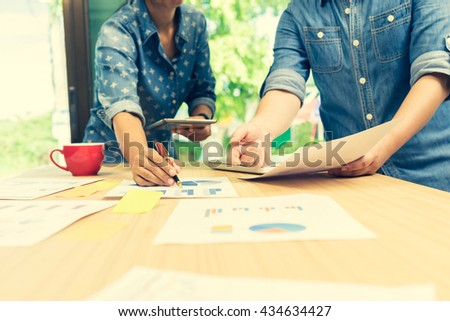 Business, business partners discussing documents and ideas at meeting Business concept, soft focus, vintage tone - stock photo