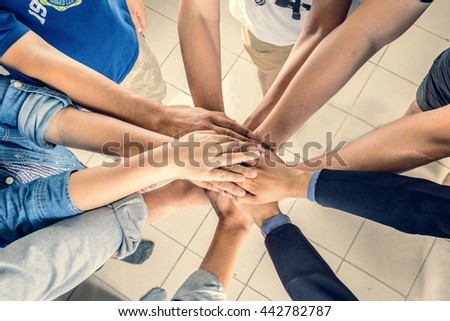 Business, business people showing unity with their hands together, soft focus, vintage tone - stock photo