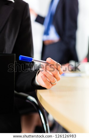 Business - businesspeople have a meeting with presentation in office, they negotiate a contract - closeup - stock photo