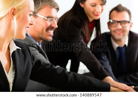 Business - businesspeople have team meeting or workshop in an office and joining hands, it is a very good team - stock photo