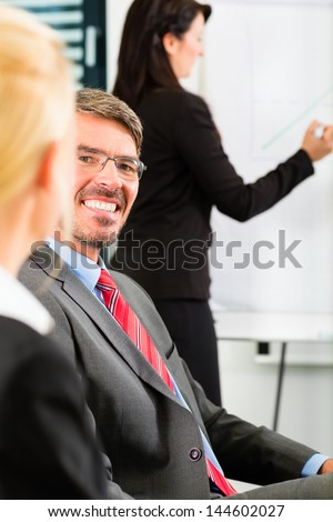 Business - businesspeople have team meeting or workshop in an office, it is a very good team �¢?? Portrait of a businessman - stock photo