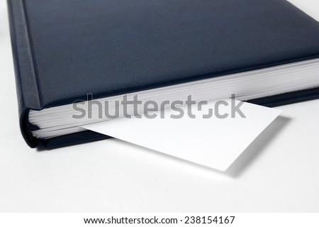 Business card as a bookmark in the book, diary - stock photo