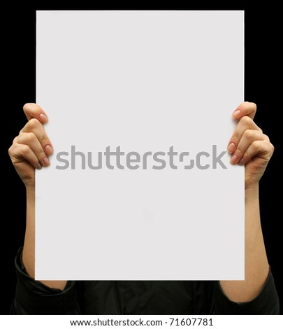business card blank in a hand on the black backgrounds - stock photo