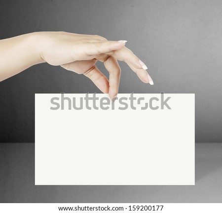 business card blanks in a hand  - stock photo