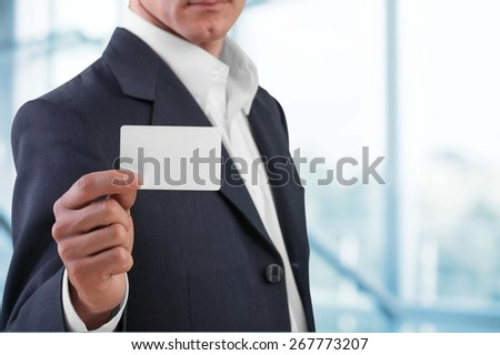 Business Card. Businessman showing his business card - stock photo