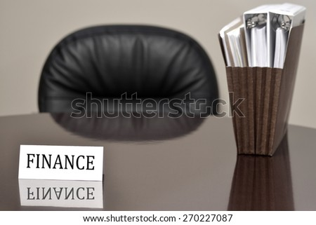 Business card for finance loans lending on desk with files and chair  - stock photo