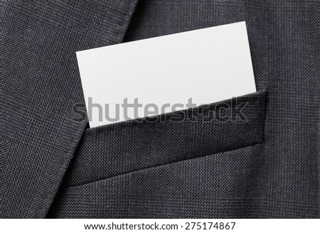 Business card in a suit pocket - stock photo