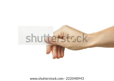 Business card in hand - stock photo
