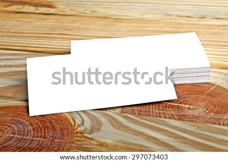 Business card on wooden background - stock photo