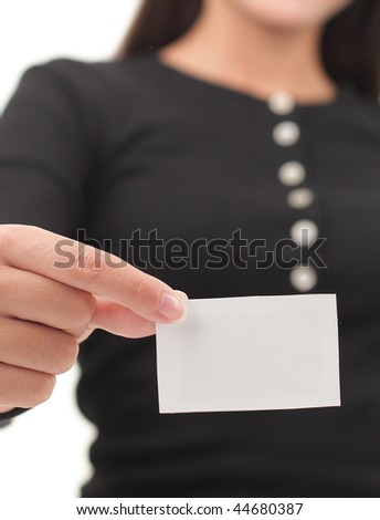 Business card or blank white paper sign. Shallow depth of field, focus on card. - stock photo