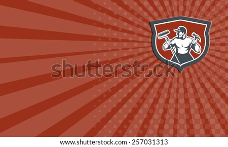 Business card showing illustration of a carpenter holding hammer and paint roller looking to side set inside shield crest on isolated background done in retro style.  - stock photo