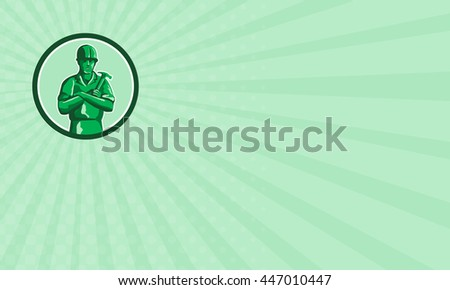 Business card showing illustration of a green plastic toy builder construction worker standing wearing hard hat holding hammer arms crossed viewed from front set inside circle done in retro style.  - stock photo