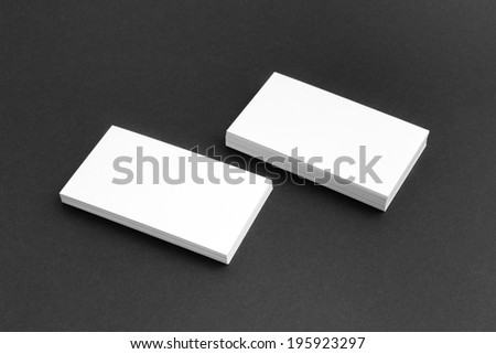 Business card template mockup for branding identity and logo prints with blank modern devices. Isolated on black paper background. - stock photo