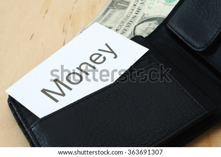 Business card with the sign Money in wallet with dollars   - stock photo