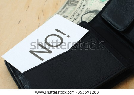 Business card with the sign NO! in wallet with dollars   - stock photo