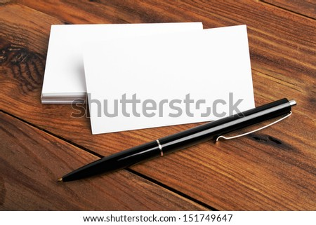Business cards and pen on a desk - stock photo
