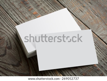 Business cards on wood table ( with separate layer clipping path : Card upper,Card lower ) - stock photo