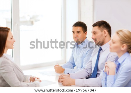 business, career and office concept - businesswoman at job interview in office - stock photo