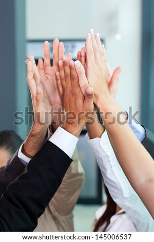 business celebration for good teamwork with high five - stock photo
