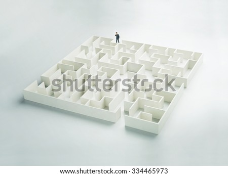 Business challenge. A businessman at the entrance to a maze. Front view - stock photo