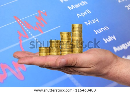 Business chart is made from golden coins, shows an increase, isolated - stock photo