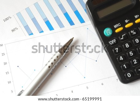 business chart of earnings trends with office equipment - stock photo