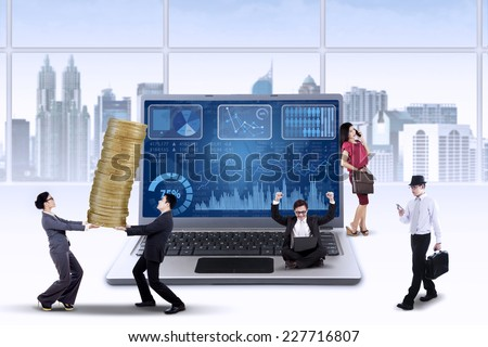 Business chart on laptop with busy entrepreneurs manage their business to increase profit - stock photo