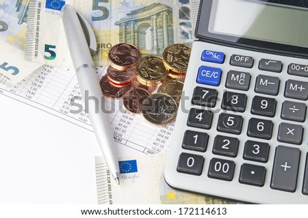 Business chart with calculator, pen and coins - stock photo