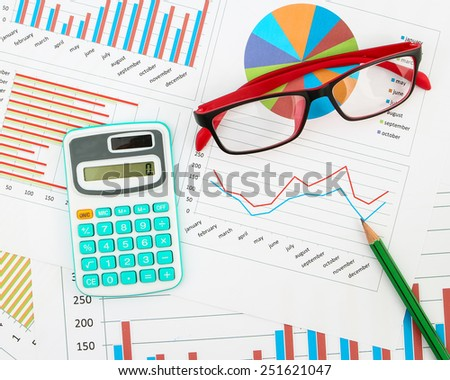Business chart with calculator, pencil and glasses. - stock photo