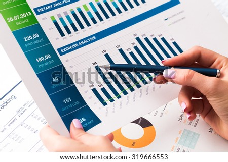 Business charts and graphs close up - stock photo