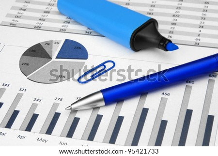 Business Charts blue with marker pen and paper-clip - stock photo