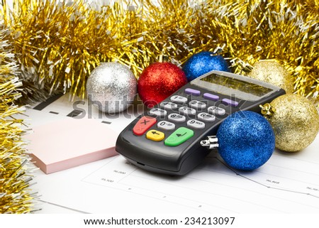 Business Christmas of a payment terminal, sticker, balls, tinsel - stock photo