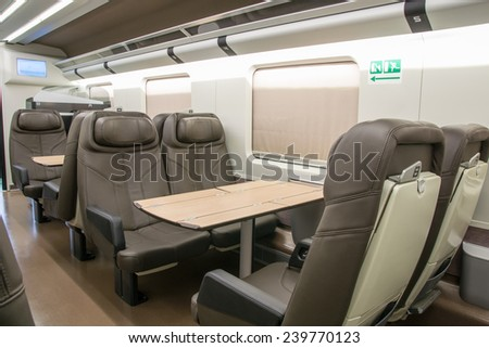 business class with leather seats of a railroad car - stock photo