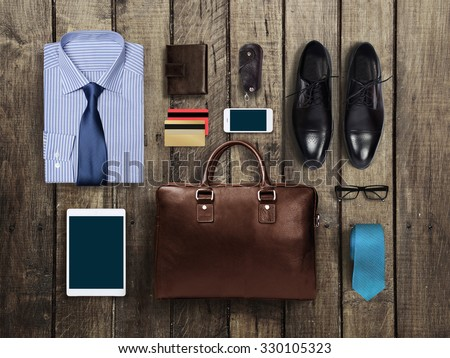 business clothes on a wooden background - stock photo