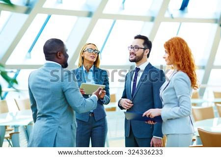 Business co-workers interacting at meeting - stock photo