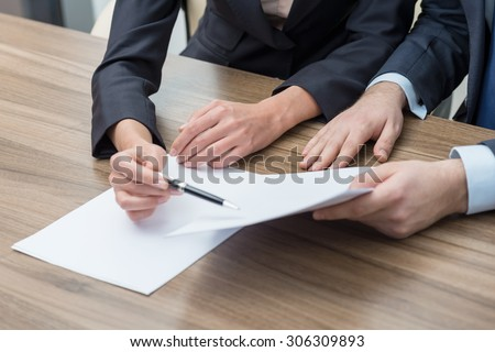 Business colleagues are working on the papers. Toning filter. - stock photo
