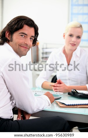 Business colleagues chatting at work - stock photo