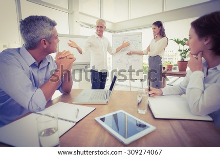 Business colleagues conducting presentation in the office - stock photo