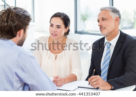 Business colleagues discussing during meeting in office - stock photo