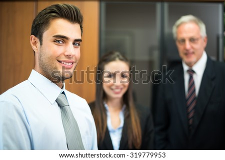 Business colleagues in an office - stock photo
