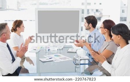 Business colleagues watching video presentation in work - stock photo
