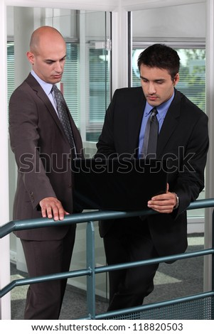 Business colleagues with a laptop - stock photo