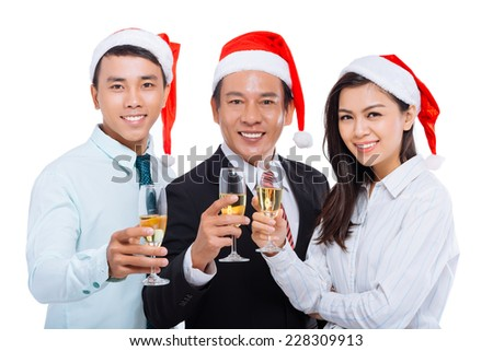 Business colleagues with champagne flutes wishing Merry Christmas - stock photo