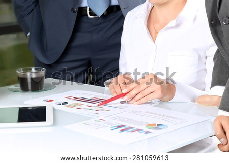 Business colleagues working and analyzing financial figures