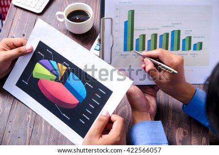 Business colleagues working and analyzing financial figures - stock photo