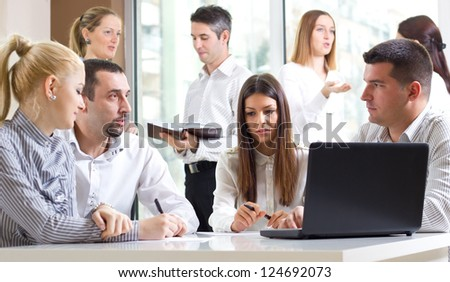 Business colleagues working on a laptop - stock photo