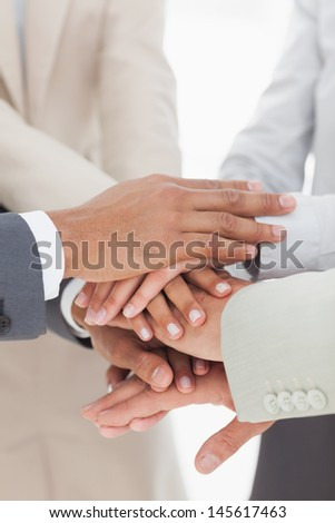 Business colleauges hands together in unity - stock photo