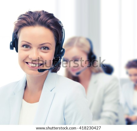 business, communication and call center concept - female helpline operator with headphones - stock photo